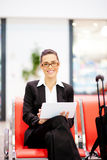 Businesswoman using tablet at airport. Young beautiful businesswoman using tablet at airport Stock Image