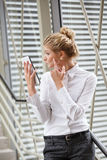 Businesswoman using tablet as a mirror Royalty Free Stock Photos