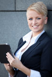 Businesswoman using tablet Royalty Free Stock Images