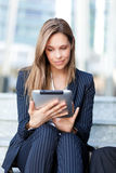 Businesswoman using a tablet stock image