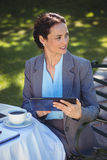 Businesswoman using tablet with coffee Stock Photos