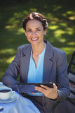 Businesswoman using tablet with coffee Royalty Free Stock Images