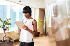 Businesswoman using tablet computer in office Royalty Free Stock Photography
