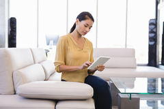 Businesswoman using tablet computer in office Stock Image