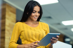Businesswoman using tablet computer Stock Images