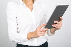Businesswoman Using Tablet Computer on White Background Royalty Free Stock Photo