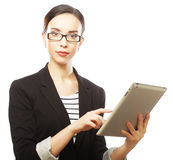 Businesswoman using tablet computer Stock Photography
