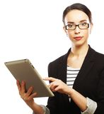 Businesswoman using tablet computer Stock Photo