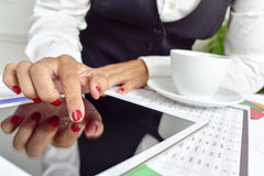 Businesswoman using a tablet computer Stock Image