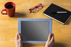 Businesswoman using tablet at desk Stock Images