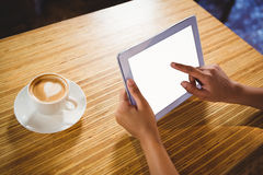 A businesswoman using a tablet and enjoying a coffee Royalty Free Stock Photography