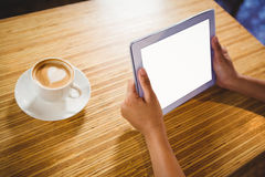 A businesswoman using a tablet and enjoying a coffee Royalty Free Stock Photos
