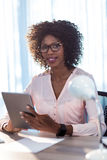 Businesswoman using a tablet Royalty Free Stock Photo