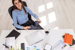 Businesswoman using tablet in office Royalty Free Stock Photos
