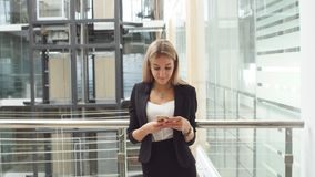 Businesswoman Using Tablet in Office Building.  stock footage