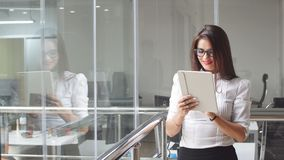 Businesswoman Using Tablet in Office Building.  stock video footage