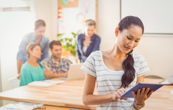 Businesswoman using tablet in the office Stock Photos