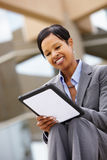 Businesswoman using tablet outdoors Stock Images