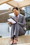 Businesswoman using tablet outdoors Royalty Free Stock Images