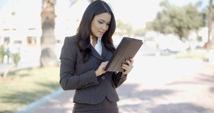 Businesswoman Using Tablet Outdoors Stock Photography