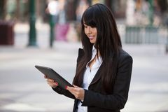 Businesswoman using tablet pc. Smiling business woman using tablet pc Stock Photography