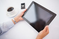 Businesswoman using tablet pc at her desk Royalty Free Stock Image
