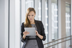 Businesswoman using tablet PC in office Stock Images