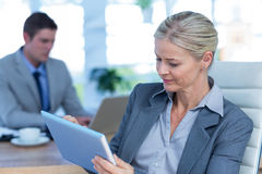 Businesswoman using tablet pc Stock Photos