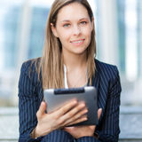 Businesswoman using a tablet stock photos