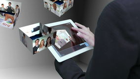 Businesswoman using tablet to view montage of business people at work stock footage