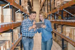 Businesswoman using tablet in warehouse royalty free stock photos