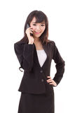 Businesswoman using or talking via smartphone Royalty Free Stock Photography