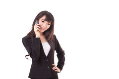 Businesswoman using or talking via smartphone, studio shot Stock Images