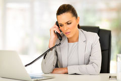 Businesswoman using telephone Stock Images