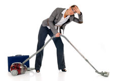 Businesswoman vacuum cleaner Royalty Free Stock Photography