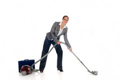 Businesswoman vacuum cleaner Royalty Free Stock Photos