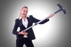 Businesswoman with vacuum cleaner Royalty Free Stock Photo