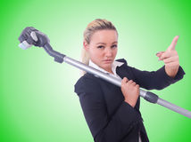 Businesswoman with vacuum cleaner on white Stock Photo