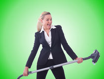 Businesswoman with vacuum cleaner on white Stock Images