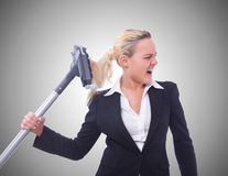 Businesswoman with vacuum cleaner on white Royalty Free Stock Photos