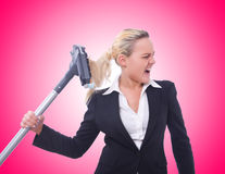 The businesswoman with vacuum cleaner on white Stock Photography