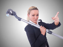 The businesswoman with vacuum cleaner on white Royalty Free Stock Photo