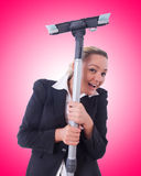 The businesswoman with vacuum cleaner on white Stock Images