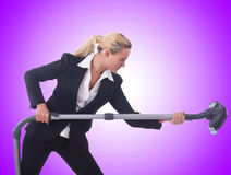 The businesswoman with vacuum cleaner on white Royalty Free Stock Image