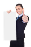 Businesswoman with vertical empty banner Stock Photo