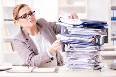 The businesswoman very busy with ongoing paperwork. Businesswoman very busy with ongoing paperwork stock images