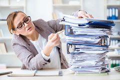 The businesswoman very busy with ongoing paperwork. Businesswoman very busy with ongoing paperwork Stock Image