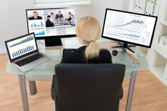 Businesswoman Video Conferencing On Computer Stock Photos