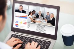 Businesswoman video conferencing with laptop Stock Photo