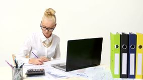 Businesswoman viewing financial statements and stock video
